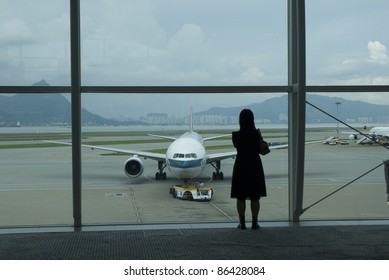 HONG KONG-AUG 24:Silhouette of a tourist takes a photo at Hong Kong International Airport in Hong Kong August 24, 2007. The airport opened for commercial operations in 1998, replacing Kai Tak airport