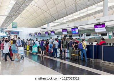 HONG KONG-AUGUST 15, 2017: Passengers check-in at a Qatar Airways flight at the Hong Kong International Airport. This airport was opened in 1998 and has an area of 12.75 square kilometers.