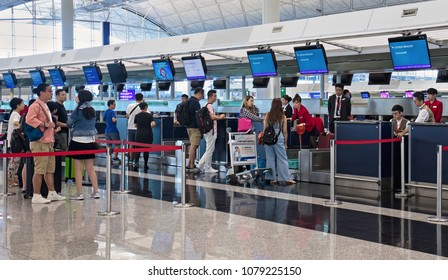 HONG KONG-AUGUST 15, 2017: Passengers check-in at a Cathay Dragon flights at the Hong Kong International Airport. This airport was opened in 1998 and has an area of 12.75 square kilometers.