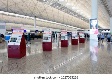 HONG KONG-AUGUST 15, 2017:  Self check-in machines are seen at the Hong Kong International Airport. This airport was opened in 1998 and has an area of 12.75 square kilometers.