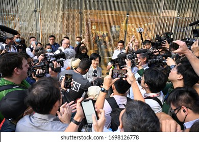 HONG KONG,Central,2019NOV25,in military thug tyranny dictatorship failed state,leader of gangster appear in street,collusion of masked police occupied & block the road,made a chaotic social order