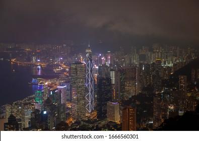 Hong Kong/China - July 05 2019: Cityscape Hong Kong buildings with flashing lights at night