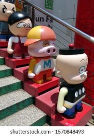 Hong Kong/China-May 28, 2018:  Four cartoon characters lined up a set of stairs adjacent to Kowloon Park.