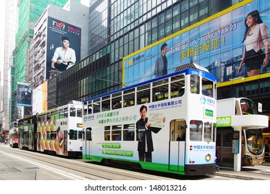 HONG KONG-FEBRUARY 14: Double-decker trams with advertisements at Hennessy Rd. Road show provides advertisements to the passengers of public transit vehicles on Febuary 14,2013 in Hong Kong