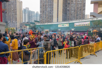 Hong Kong-February 5, 2019:People are seen at Wong Tai Sin Temple on the first day of Chinese New Year. Wong Tai Sin Temple, a Taoist temple established in 1921, is a famous temple in Hong Kong.