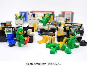 HONG KONG,MARCH 22: Studio shot of Lego people in office, combine from different set. Legos are a popular line of plastic construction toys manufactured by The Lego Group in Denmark