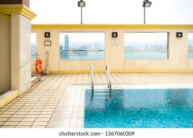 Hong Kong,March 24,2019:pool on the top floor of a skyscraper in Hong Kong during a hazy day