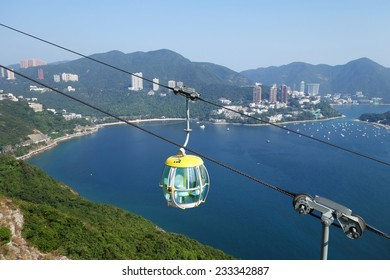 HONG KONG-NOV 21: Tourists travel in cable car in the ocean park, Hong Kong on on November 19, 2014. Cable cars is one of attraction in the park.