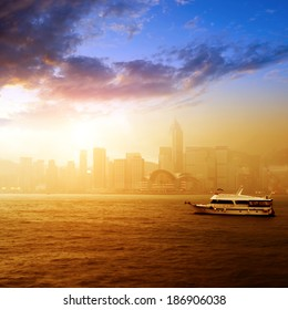 Hong Kong's Victoria Harbour fog sunrise, modern Asian city.