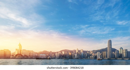 Hong Kong's Victoria Harbour in sunrise with text welcome to Hong Kong City