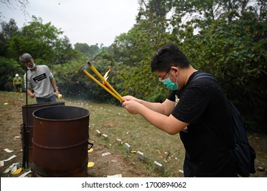 HONG KONG,SandyRidgeCemetery,2020APR 5,ChingMing Festival,a death memorial day.Burning joss sticks for pray & worship innocent victims killed by military armed bastard police rioters