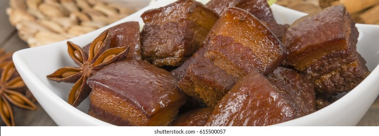 Hong Shao Rou (Red Cooked Pork) - Chinese pork belly caramelized and braised in soy sauce with star anise, cinnamon and chilies.