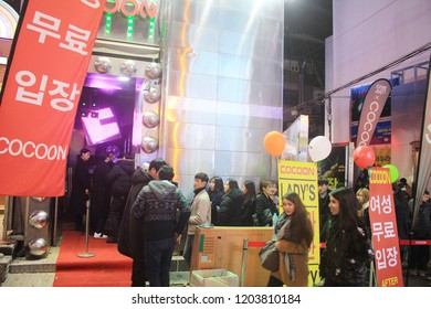 Hongdae, Seoul, South Korea - Dec 01, 2017: People line up for waiting to enter inside Cocoon club. It is one of the prominent and biggest clubs in Hongdae.