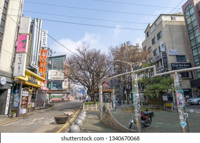 Hongdae street lined up with various restaurants, shops, and bars. Hongdae is a famous shopping and clubbing district in Seoul, South Korea. Taken on March 17th 2019. Seoul, South Korea