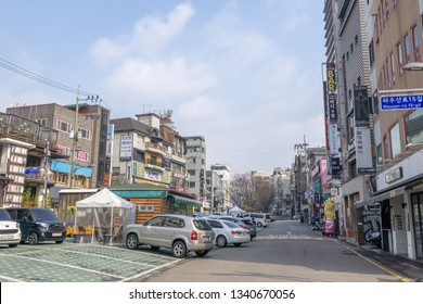 Hongdae street parking lot and various restaurants and bars alongside it. Hongdae is a famous shopping and clubbing district in Seoul, South Korea. Taken on March 17th 2019.