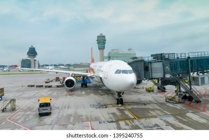 HONGKONG AIRLINES-MAY 3, 2019: Hongkong Airlines, Airbus A330 parking and loading cargo, waiting passenger at the Hongkong international airport