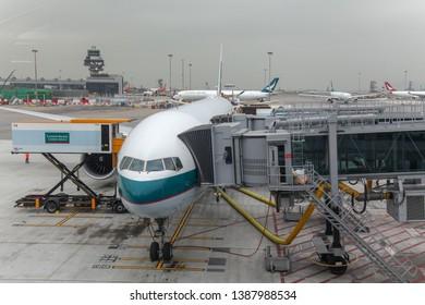 Hongkong airport,hongkong-December 6,2018: Plane cathay pacific airline stop in gate hongkong international airport at hongkong