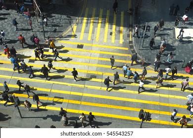 HONGKONG, CHINA - December 8 2016: Unidentified pedestrians on zebra crossing street on December 8, 2016 in Hongkong, China.