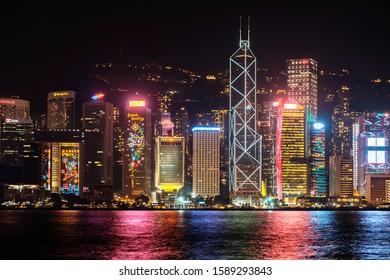 HongKong, China - November, 2019: Christmas decoration on Hong Kong city skyscrapers. Hongkong Island skyline at night