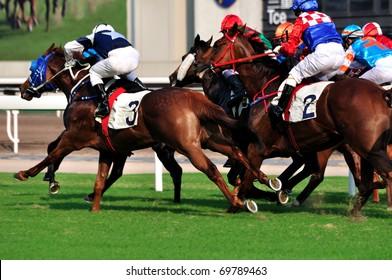 HONGKONG, CHINA - SEPT 26: Horse racing in Shatian racing field of Hongkong jockey club on September 26, 2009 in Hong Kong.