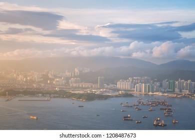 Hongkong cityscape and sunlight beside the sea