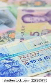 Hongkong dollars  and chinese money (renminbi) - Yuan bank notes. Concept photo for money, banking ,currency and foreign exchange rates