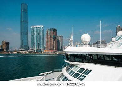 HongKong, Hong Kong - November, 2019: Cruise Ship and HongKong skyscraper skyline  at the Hong Kong cruise terminal, Kowloon