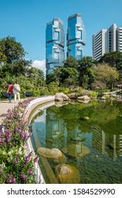 HongKong - November 18, 2019: The Hong Kong Park with lake and skyscrapers buildings in background in HongKong business district