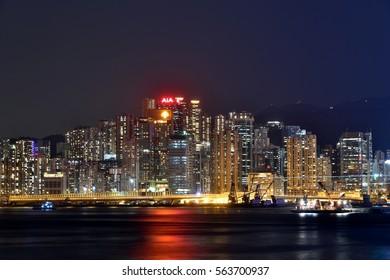 HONGKONG - SEPTEMBER 14: Night building colorful light beside Hongkong Victoria Harbor, on September 14, 2016 in Hongkong, China. Hongkong is a big international city in South of China.