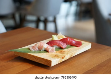 Honmaguro Sushi Set served with wasabi and ginger, Various parts of blue fin tuna (Otoro, Chutoro, Akami), Japanese food recipe.