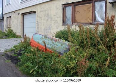 Honningsvag, Norway, August 26th 2018: Upturned rowing boat in garden, Honningsvag