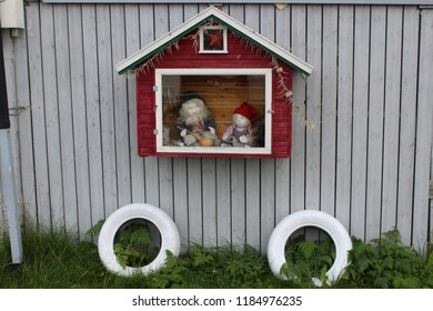 Honningsvag, Norway, August 26th 2018: Traditional Dolls in small house outside a house in Honningsvag