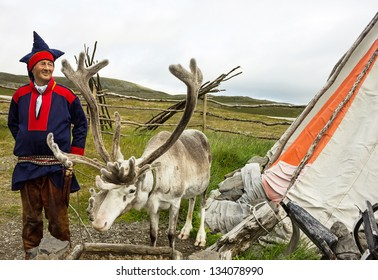 HONNINGSVAG, NORWAY: Deer and reindeer breeder dressed in national clothes the Sami in the area of town Honningsvag. The Sami are the people inhabiting the Arctic area.