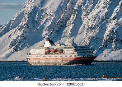 HONNINGSVAG, NORWAY -MAR 2015 : a large ferry enters the fjord where the city of Honningsvag is located in Norway, circa March 2015.