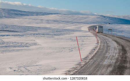 HONNINGSVAG, NORWAY -MAR 2015 : a tourist bus travels the frozen road to the North Cape, at Honningsvag,  circa March 2015.