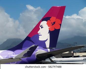 Honolulu Airport, Hawaii - Nov 19, 2015: Tail of Hawaiian Airlines Airbus 330 plane at Honolulu International Airport, Oahu Island, Hawaii, USA
