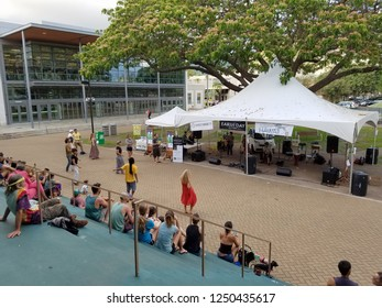 Honolulu - April 19, 2017:  People dance as Musician Taimane jams at Earth Day Concert festival on the University of Hawaii, Manoa Campus on Oahu, Hawaii.