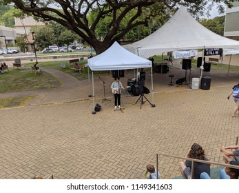 HONOLULU - April 19, 2018:  Musician Josh Sharp jams at Earth Day Concert festival on the University of Hawaii, Manoa Campus on Oahu, Hawaii