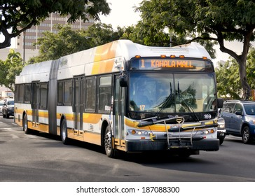 HONOLULU - APRIL 2, 2014: A Hybrid bus rides through Honolulu on April 2, 2014  The city of Honolulu purchased 60 clean diesel buses during 2013 to be more environmentally friendly.