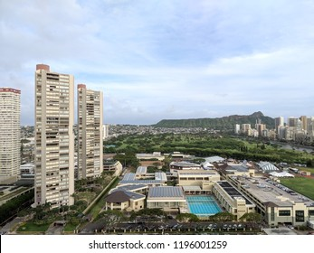 Honolulu - April 21, 2018:  Aerial View of Iolani School with Carnival, condos, Ala Wai Golf Course, Daimond head.  'Iolani School enjoys an inviting campus with wide open spaces, green lawns, place