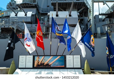 Honolulu, Awaii - May 3, 2019: Pearl Harbor, marine and memory flags at the entrance of the Missoury Battleship