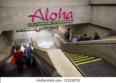 HONOLULU - DECEMBER 27, 2013: A sign welcomes people to Honolulu International Airport on December 27, 2013.   Honolulu is one of the busiest airports in the US, with 21 million passengers a year.