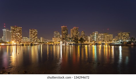 Honolulu downtown at night with seafront