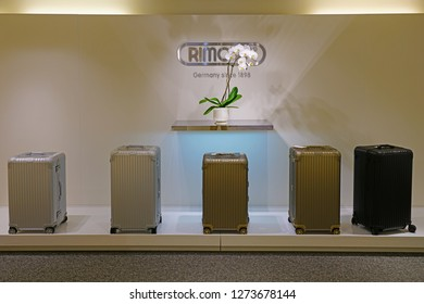 HONOLULU, HAWAII -12 DEC 2018- Display of colorful metal suitcases in a Rimowa store. Rimowa is a German company known for its sturdy aluminum and polycarbonate sturdy carry-on luggage.