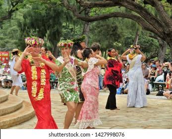 Honolulu, Hawaii - 5/2/2018 - Beautiful Hawaiian women performing traditional hula dance