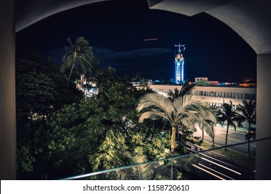 Honolulu, Hawaii 8/17/18 Aloha Tower from Harbor Court building. Part of Hawaii Pacific University campus, the blue and teal colors illuminate the tower before the start of the fall semester.