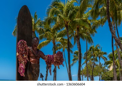 Honolulu, Hawaii - April 3, 2019: Duke Kahanamoku Statue on Waikiki Beach in Honolulu. Duke famously popularized surfing and won gold medals for the USA in swimming.
