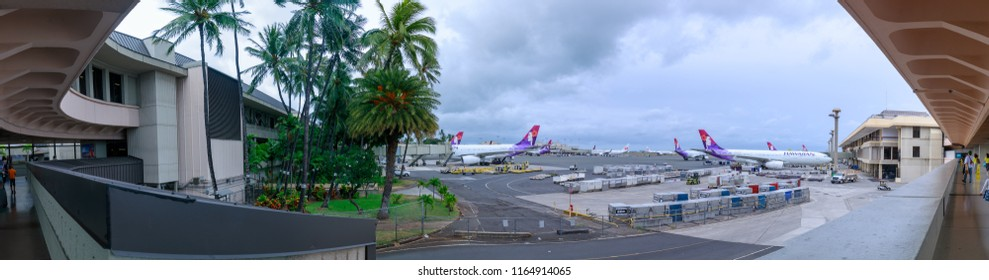 Honolulu, Hawaii - Aug 20, 2018 : Hawaiian Airlines planes on the ground and in the air at Honolulu International Airport in Hawaii