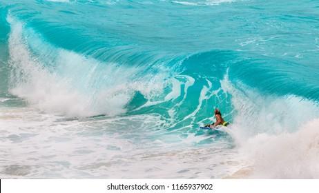 Honolulu, Hawaii - August 26, 2018: Located on Oahu's east shore, Makapuu Beach Park is arguably the island's best bodysurf and bodyboard spot.