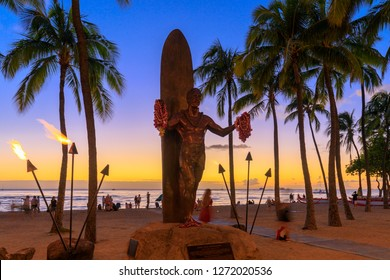 Honolulu, Hawaii - Dec 23, 2018 : Duke Kahanamoku iconic statue at sunset in Waikiki beach